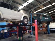Cars on a hoists at our mechanics shop at East Coast Automotive Whitianga