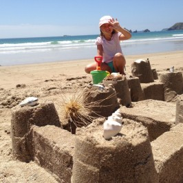 Building sand castles in Opito Bay