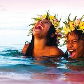 Girls with flowers in hair laughing