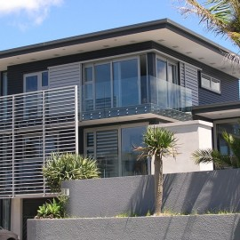 Metro Sliders with frameless glass balustrade