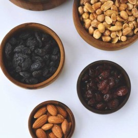 Nuts and dried fruit in bowls