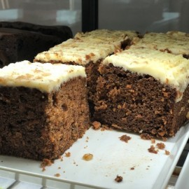 Carrot cake on tray in cabinet