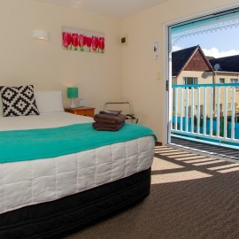 White bed with teal blanket