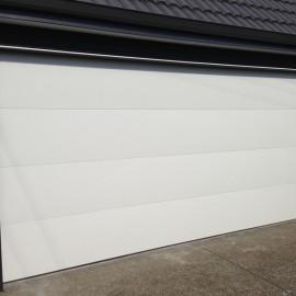 Flatline smooth color steel sectional garage door by Doors 2000 Coromandel