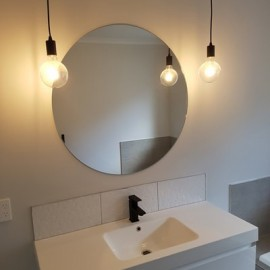 Round mirror and two light bulbs
