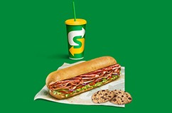 Drink, sub and cookies on a green background