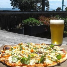 Woodfired pizza and beer with a view that never gets old.