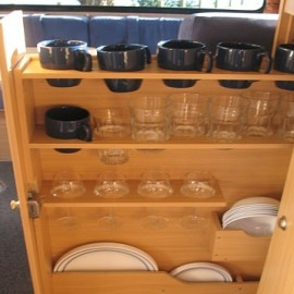 Cups and glasses in rack