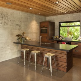 Timber and concrete kitchen bench with stools