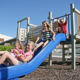 Kids playing on blue slide