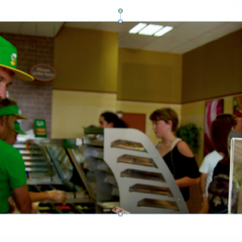Man in green shirt and hat