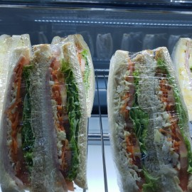Club sandwiches on tray in cabinet