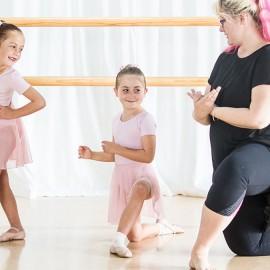 Two girls and women dancing