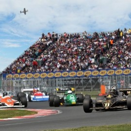 Formula one car race with crowd