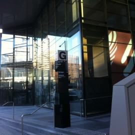 commercial glass building and side of stairs