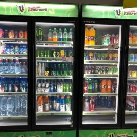 Drinks in refrigerator cabinets with clear glass doors