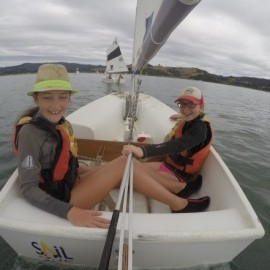 Two girls in sailing boat