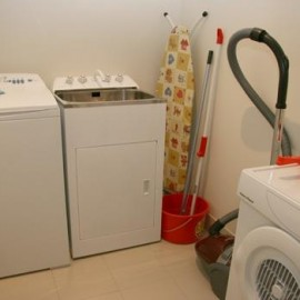 Laundry area with tub and vacuum