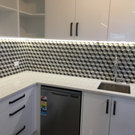 Kitchen with tiled splash back