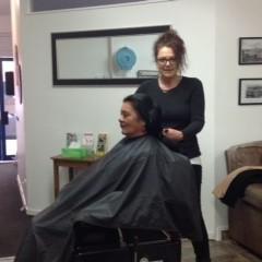 Hairdresser at work cutting hair