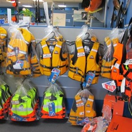 Life jackets on wall hooks