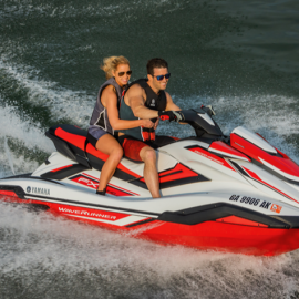 Couple on red jet ski