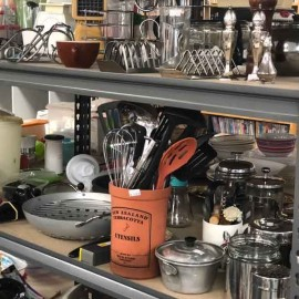 Kitchen utensils on shelf