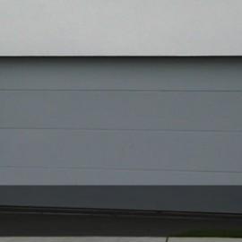 Flatline Smooth Panel sectional Garage doors by Doors 2000 Coromandel