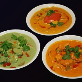 Three curries in bowls
