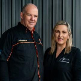 Bryan and Louana Skelton. Man and woman in dark shirts