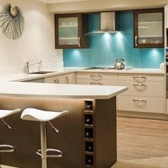 White kitchen with blue splash back