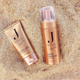 Beauty products on sand