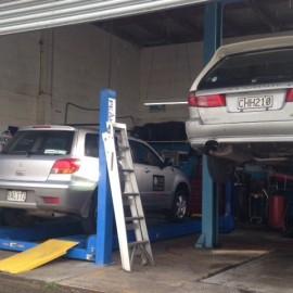 Silver cars on hoist