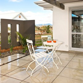 White table and chairs on patio