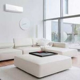 white couch and white coffee table and white heat pump in lounge area