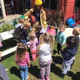 Children looking at fireman