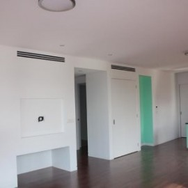 Ducted air conditioning grille in white room