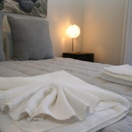 Bed with folded towels