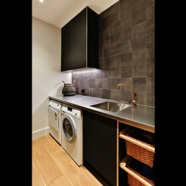 Black laundry cabinetry