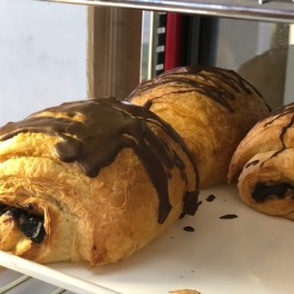 Chocolate danishes on tray in cabinet