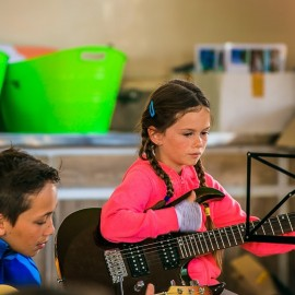 Girl and boy with guitars