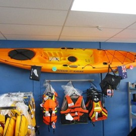 Kayak on wall and life jackets