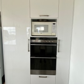 White cupboards with ovens