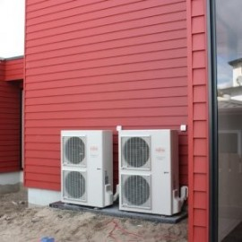 Red wall with Fujitsu outdoor air conditioning