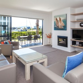 Sovereign Pier on the Whitianga Waterways apartment accommodation - lounge with patio and views to waterways