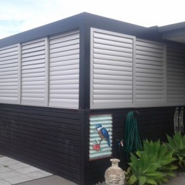 Black wall with white louvres