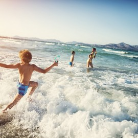 Children playing in ocean