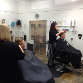 hairdressers and clients getting hair cut