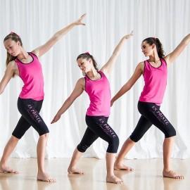 Three girls dancing in pink tops