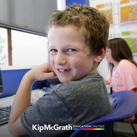 Boy at computer smiling